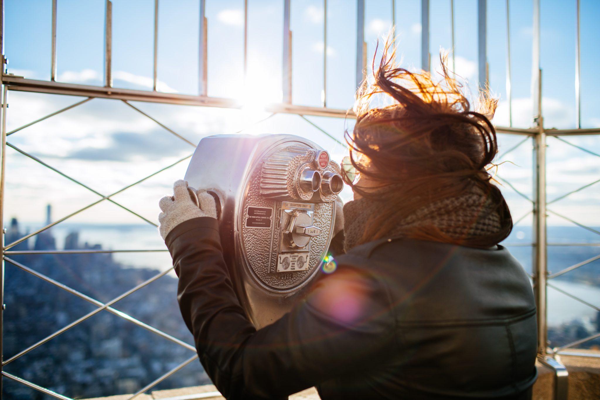 Woman looking through telescope