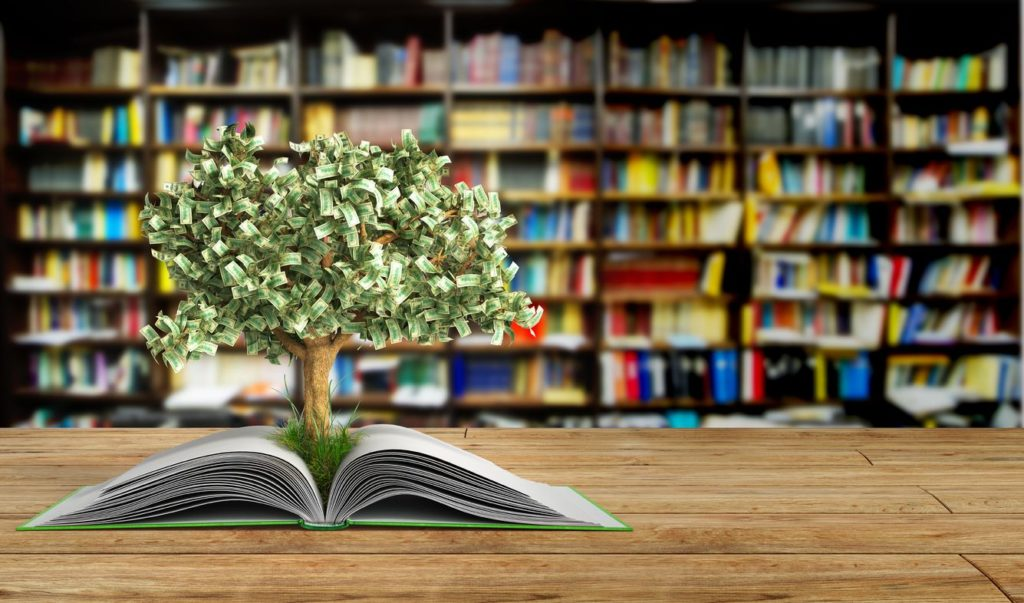 tree growing from book A big open book