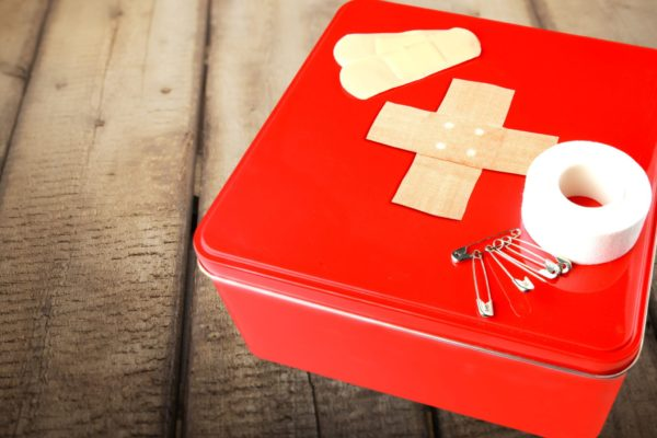 Travel first aid kit on background