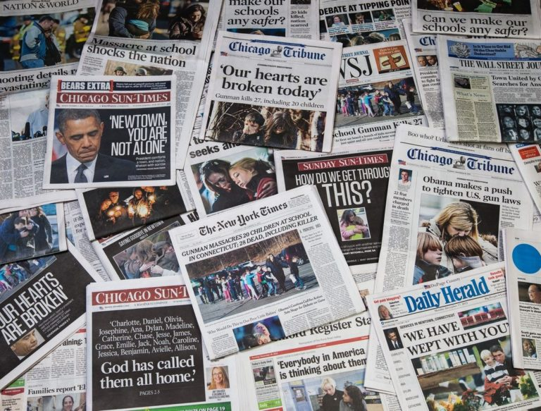 Newpapers showing headlines of school shootings