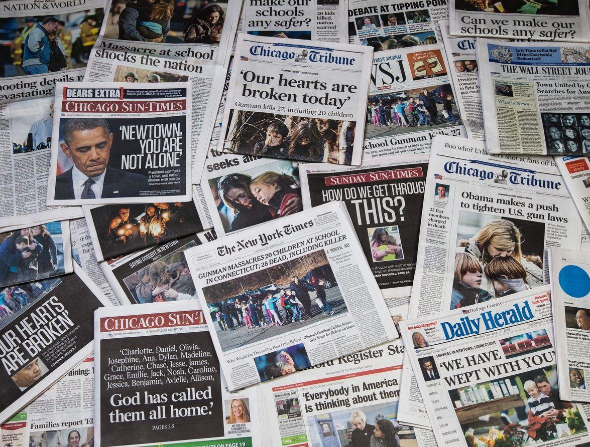 Newpapers showing headlines of school shootings